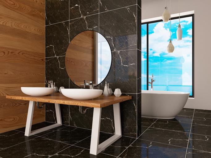 Un carrelage noir brillant dans une salle de bains moderne