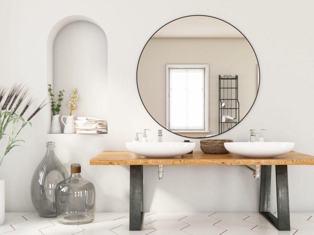 meuble double vasque miroir rond sur mur blanc et jarre sur le sol
