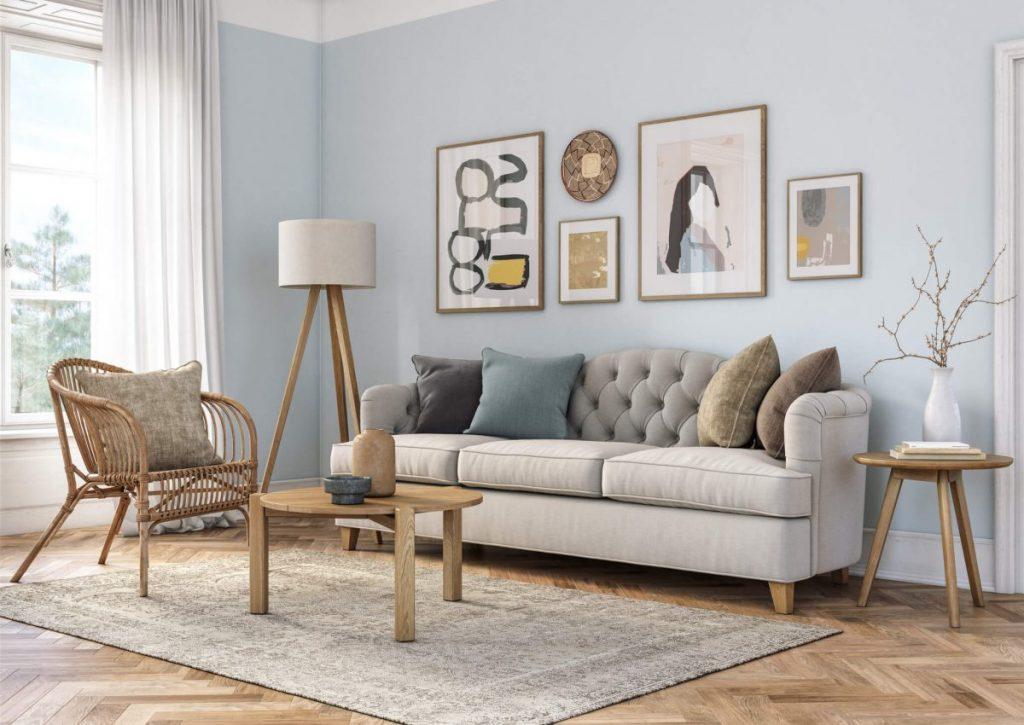 salon mur bleu clair avec tapis et meuble en bois