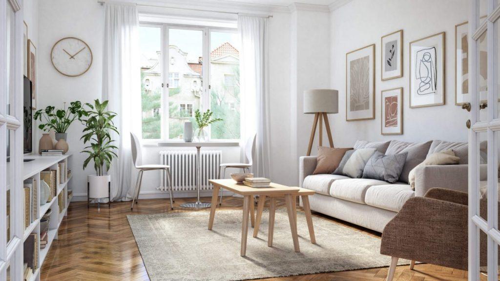 salon blanc avec bibliothèque canapé table basse et tapis