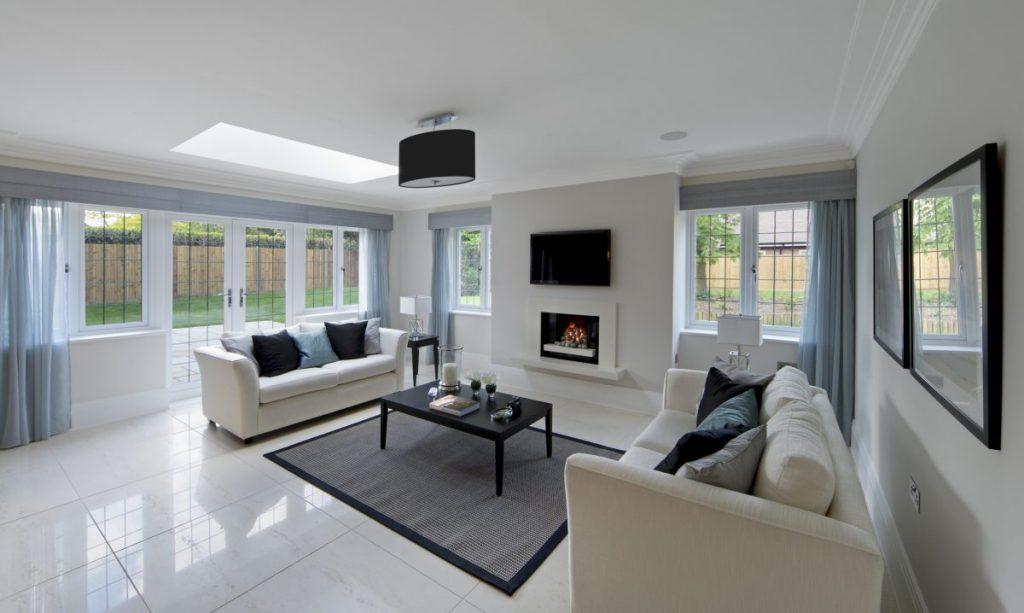 salon avec cheminée et sol en carrelage marbre
