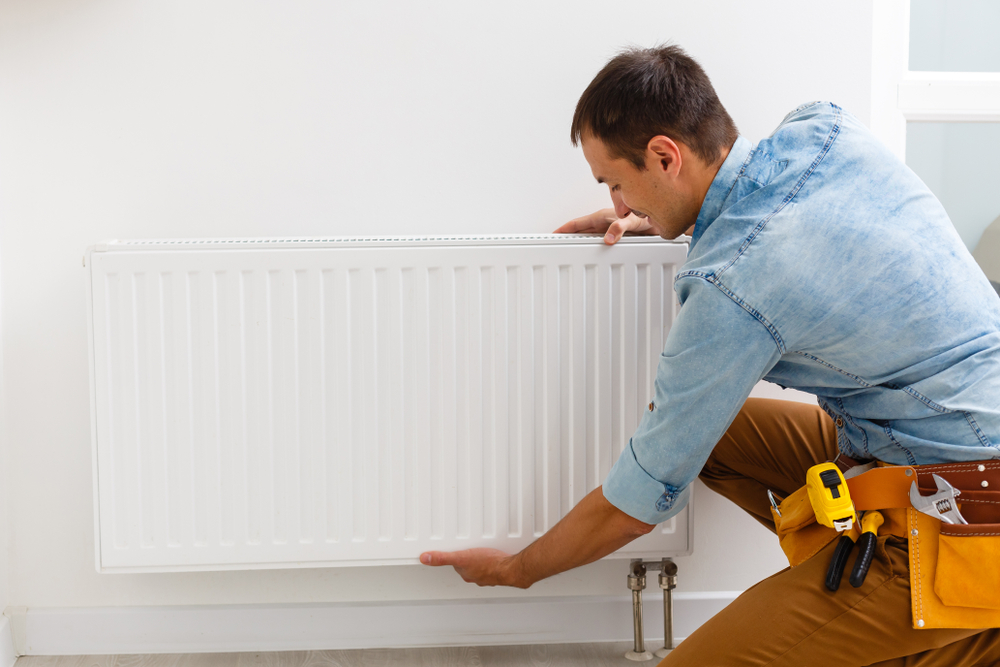 radiateur-electrique-comment-décrocher-mur